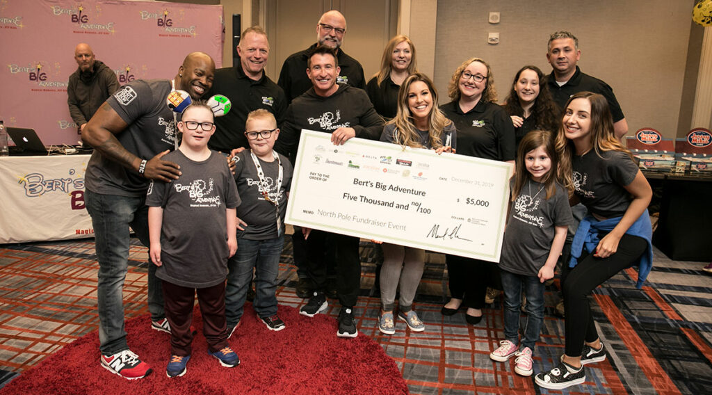 Ecotech presents check to Bert's Big Adventure 2020